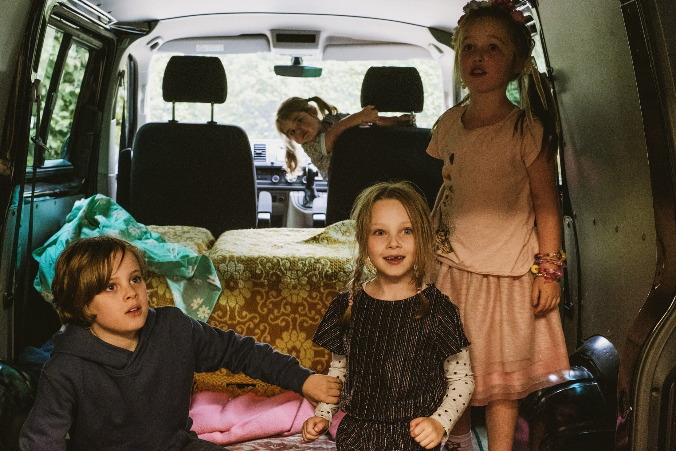 children in the back of a car playing
