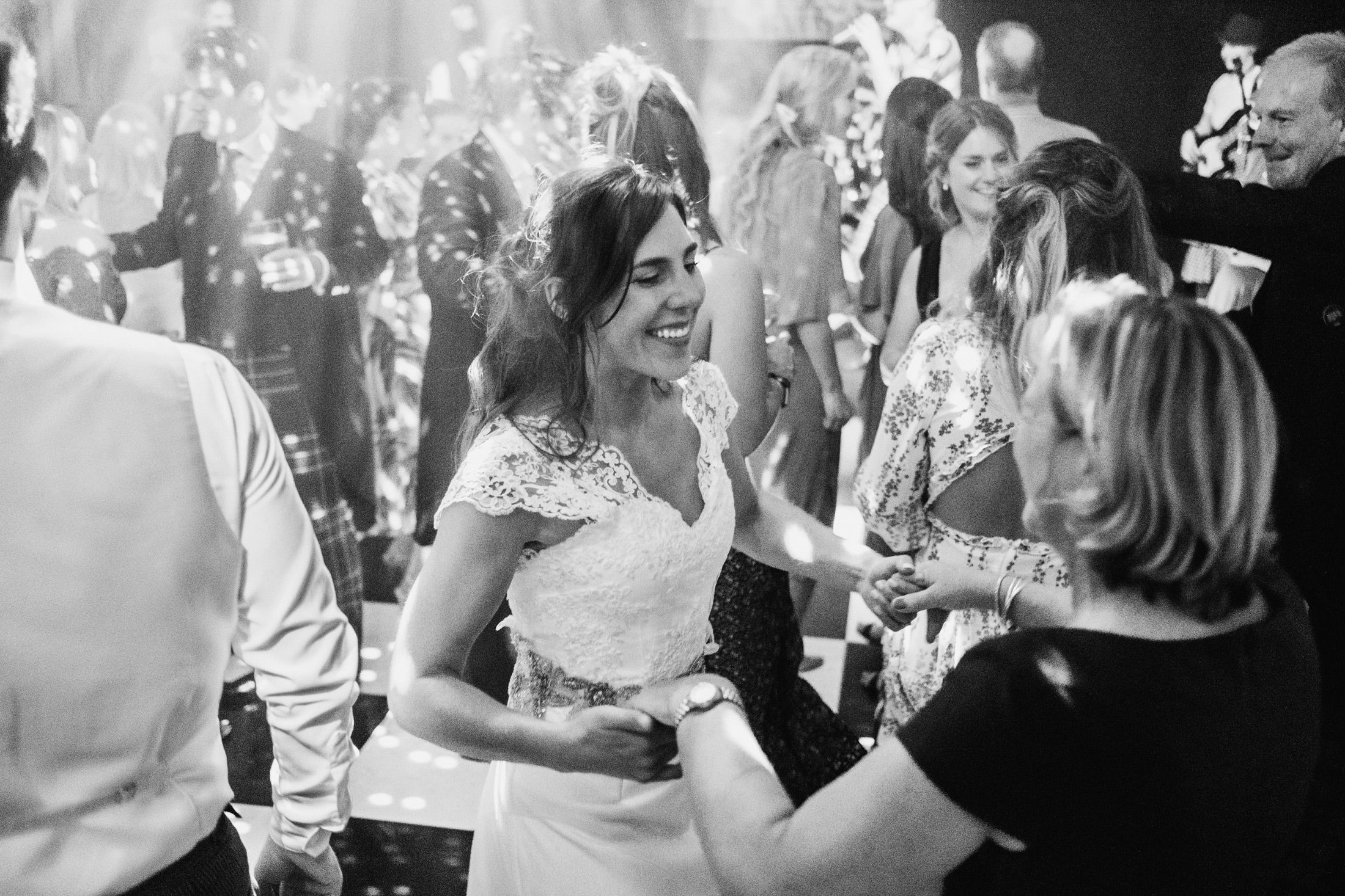 bride with friends on the dance floor