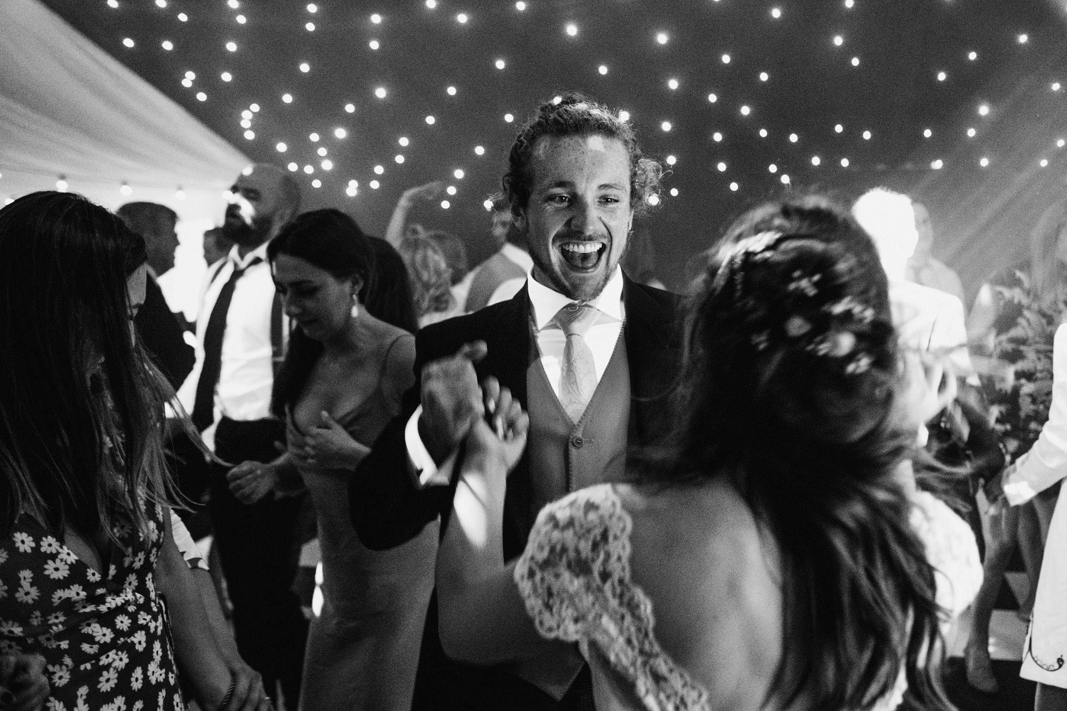 wedding guests on dance floor