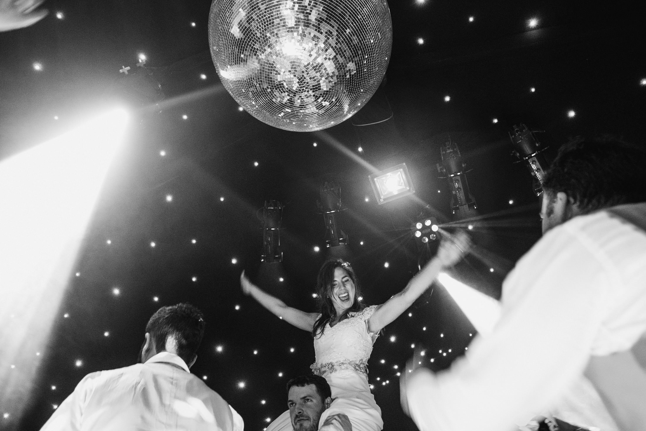 bride lifted into the air on the dance floor