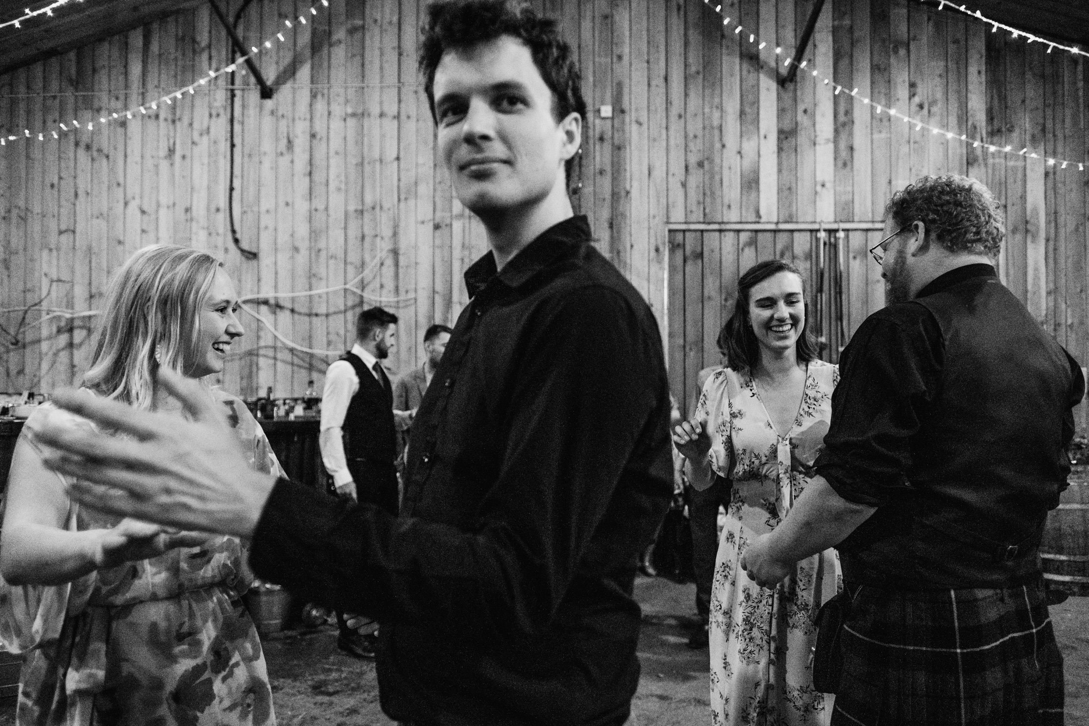 wedding guests in black and white at Comrie Croft