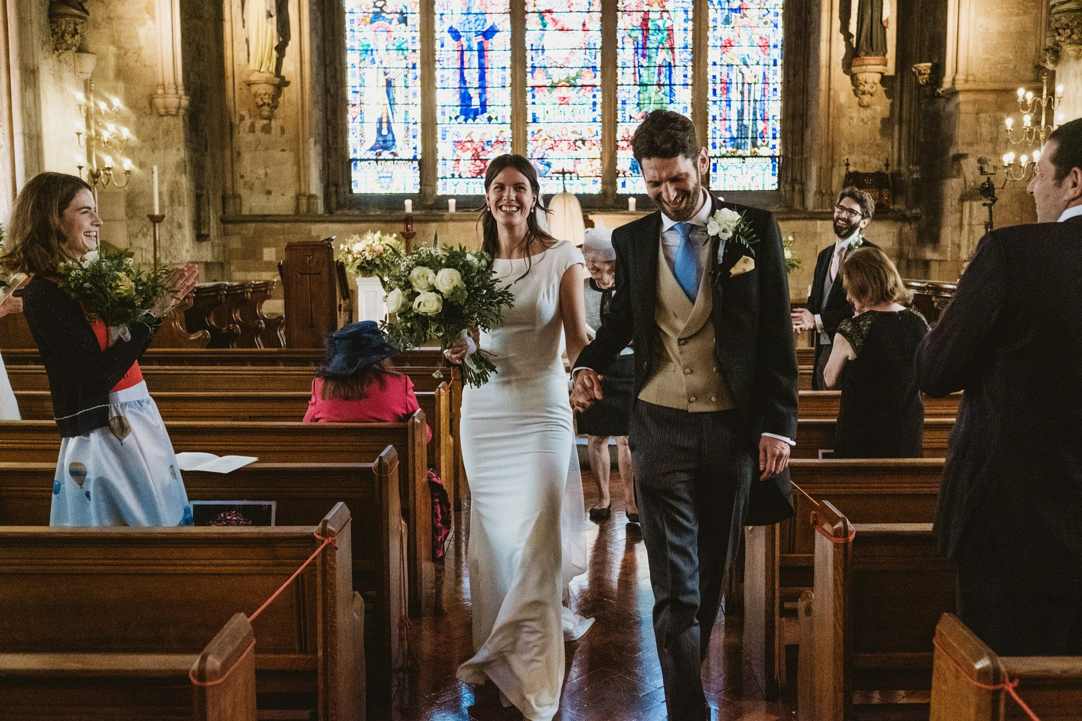 Bride and groom walk back down the aisle as husband and wife after an intimate london wedding.