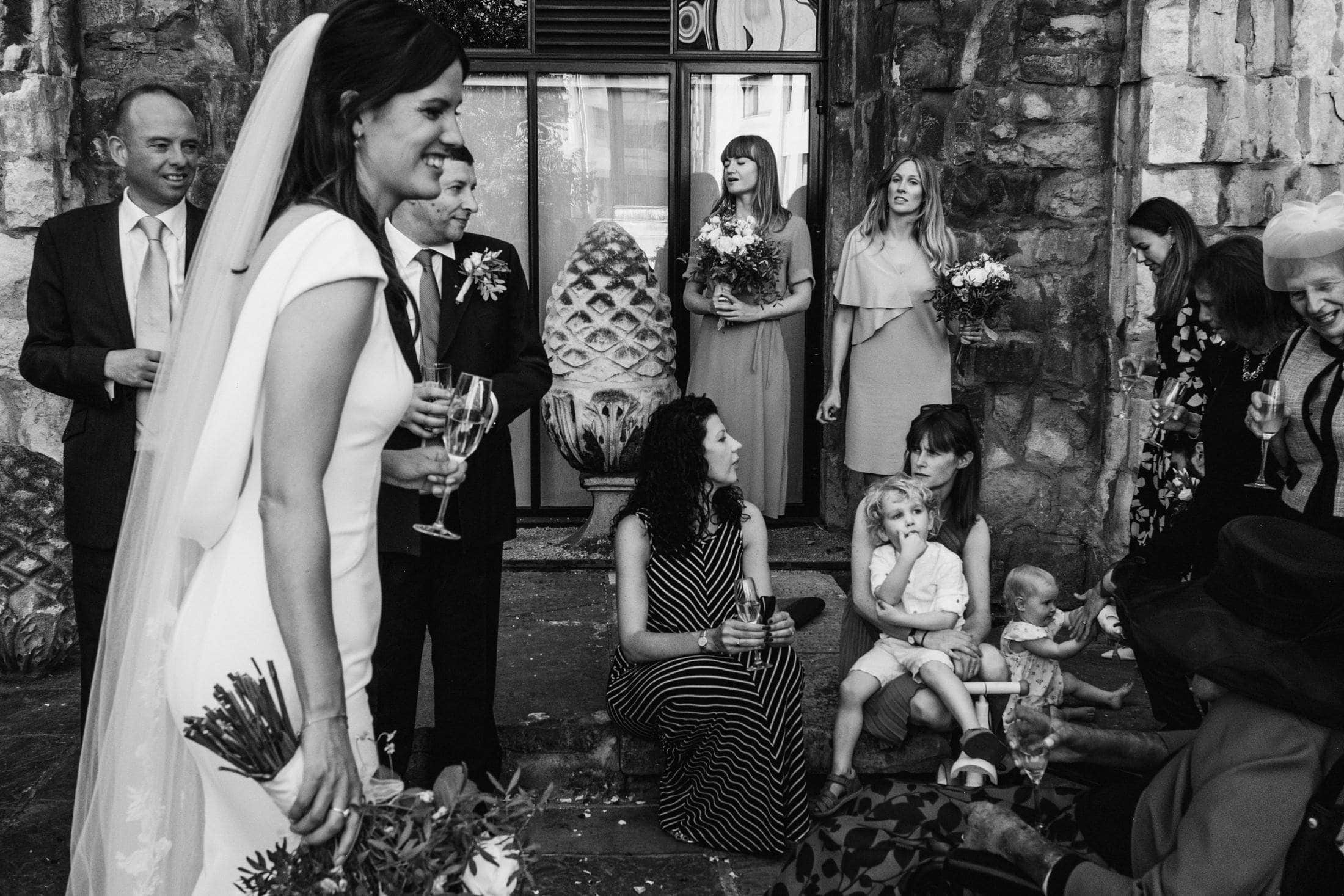 Black & white intimate London wedding photograph during an outdoor wedding reception.