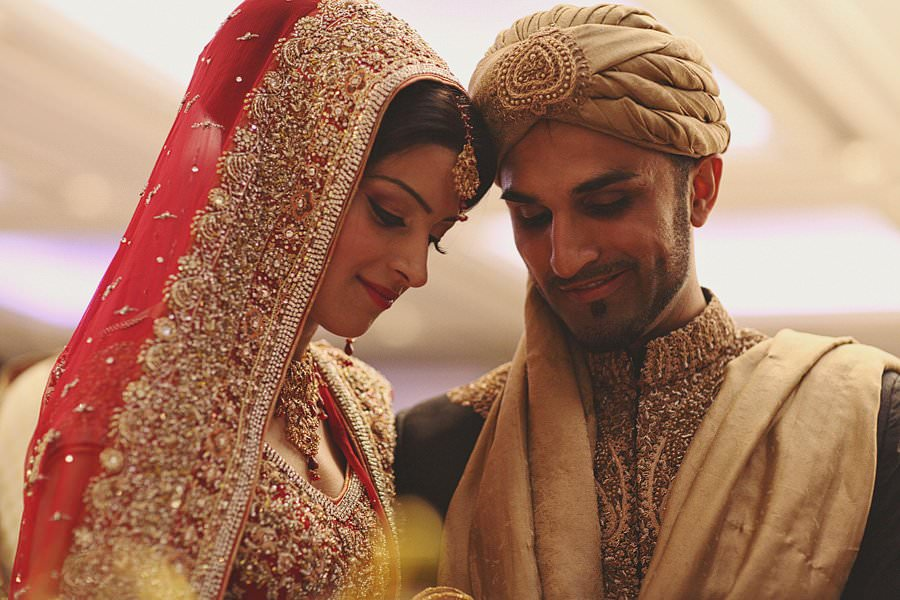 indian bride and groom heads together