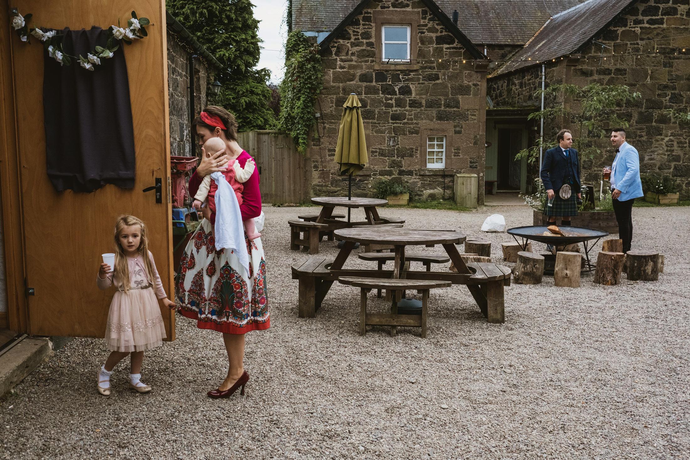 Comrie Croft wedding courtyard - documentary scene captured by York Place Studios