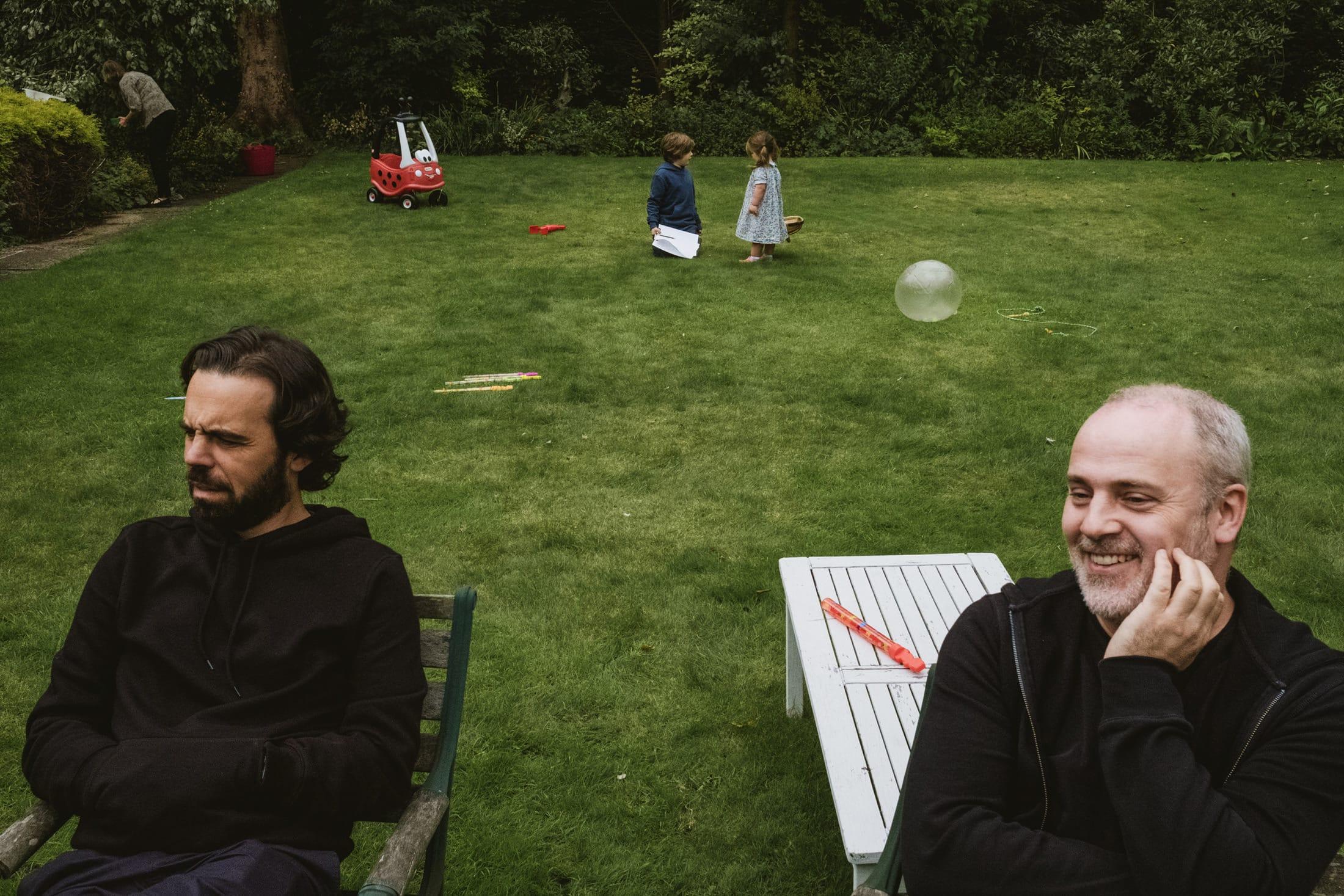 adults in garden, children talking
