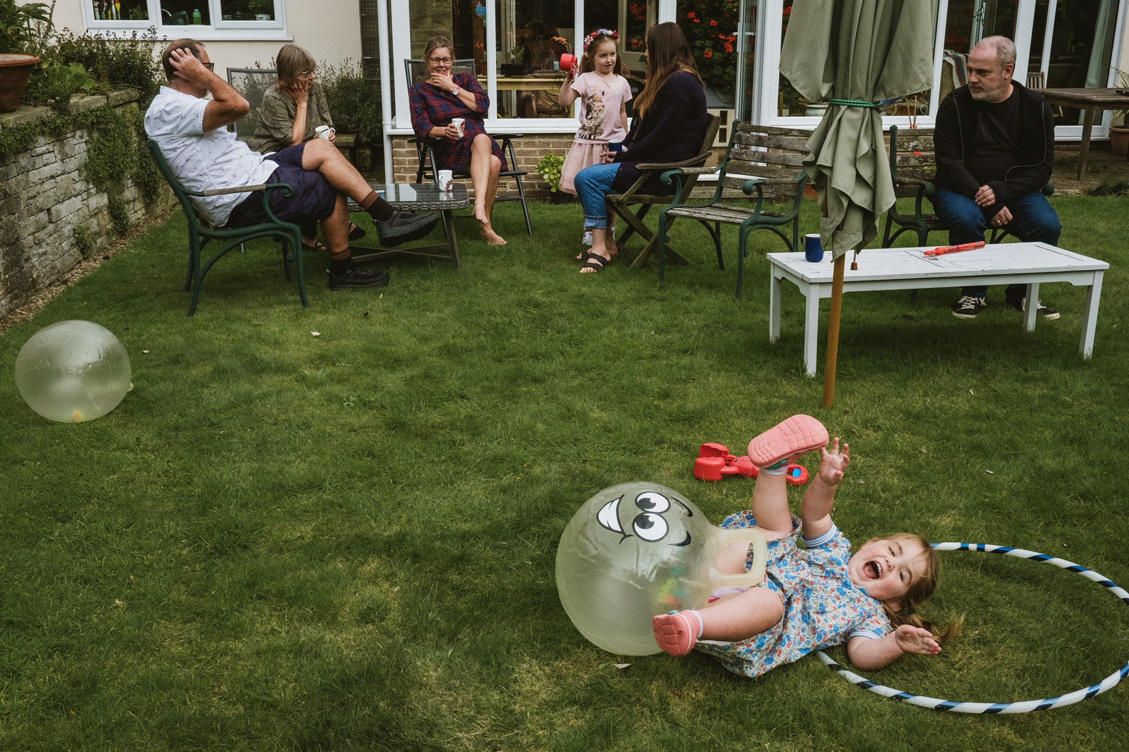 little girl fell off bouncer, laughing