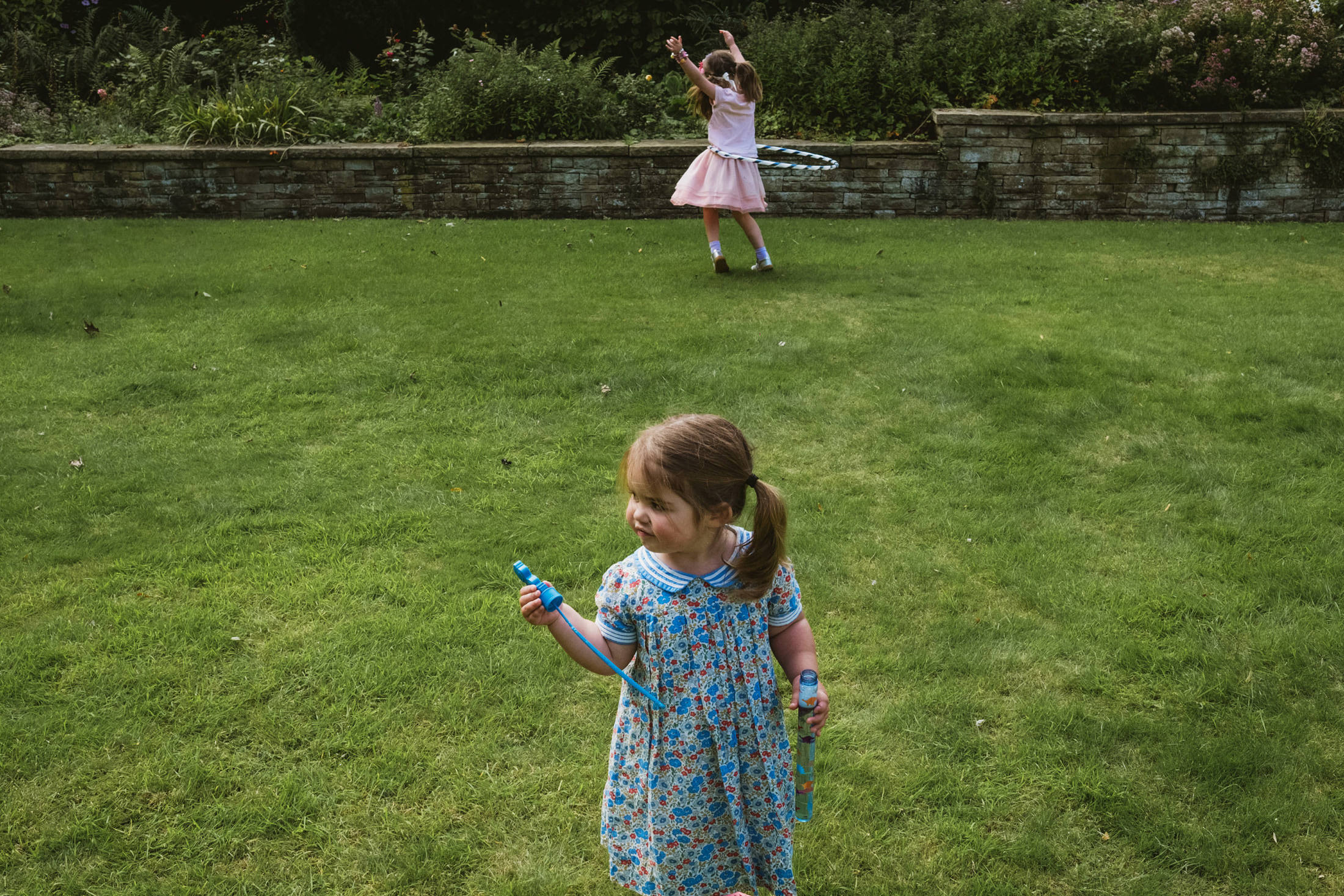 two little girls playing in the garden in Sheffield