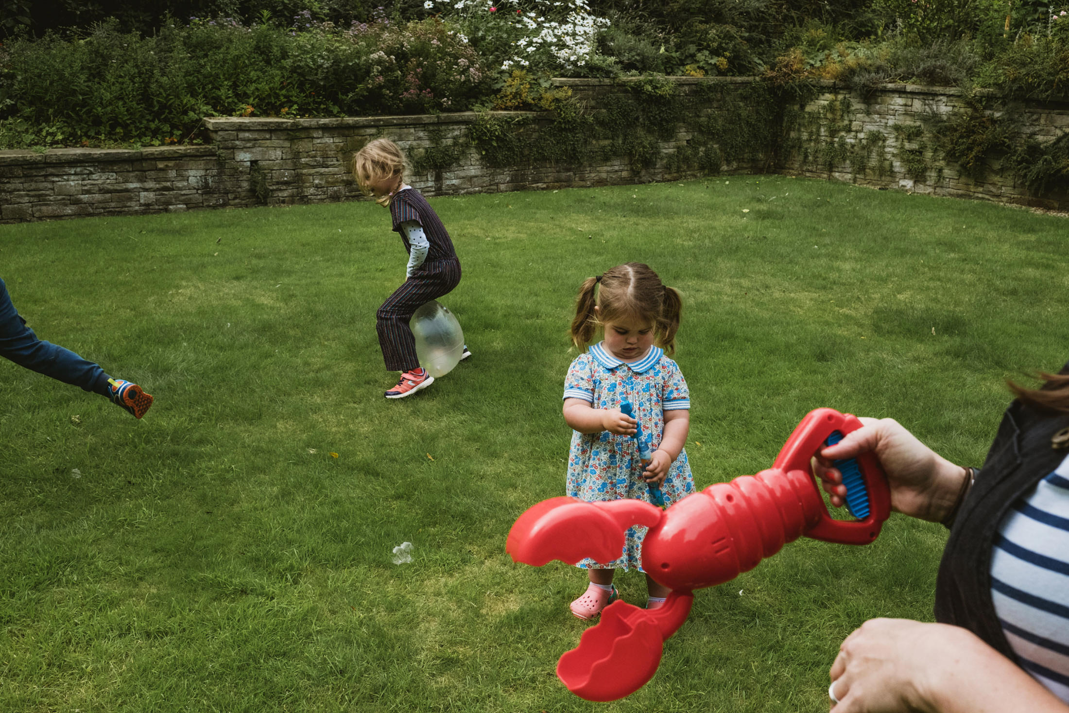 children playing with lobster hand toy