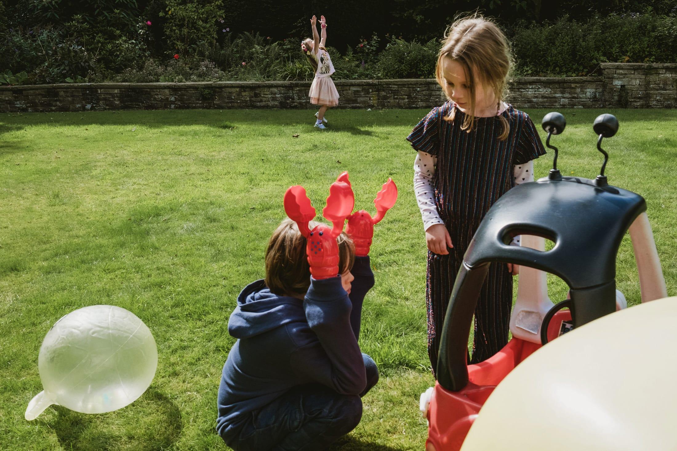 unusual shape movements by children in a garden in Sheffield